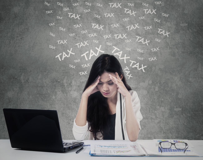 Confused woman counting her tax